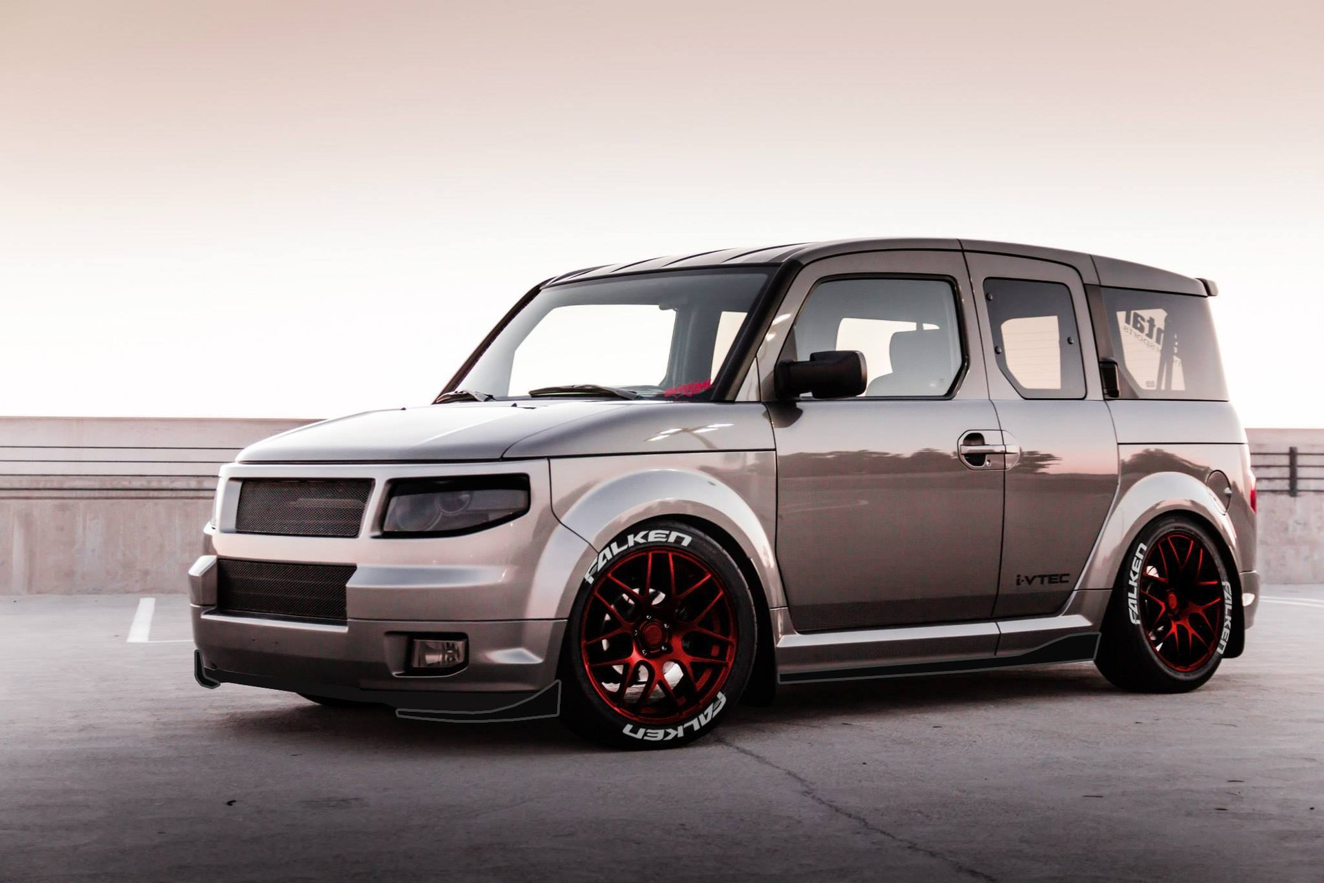 2010-2011-silver-honda-element-lowered-red-rims.jpg