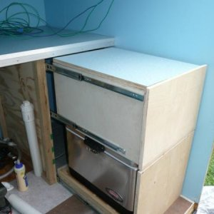 Storage cabinet and cooler drawer in kitchen.