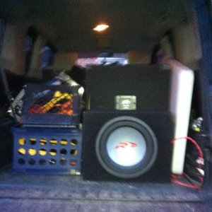 subwoofer in back with all the dj equipment