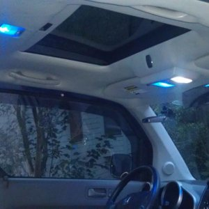 Webasto 735 Sunroof with LED's from Superbrightleds. My sunroof controls are blue and matches the overall theme. I have the Broadway bigass mirror and